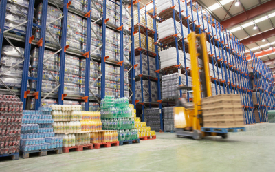 Inside a CJR warehouse a forklift loads boxes of food