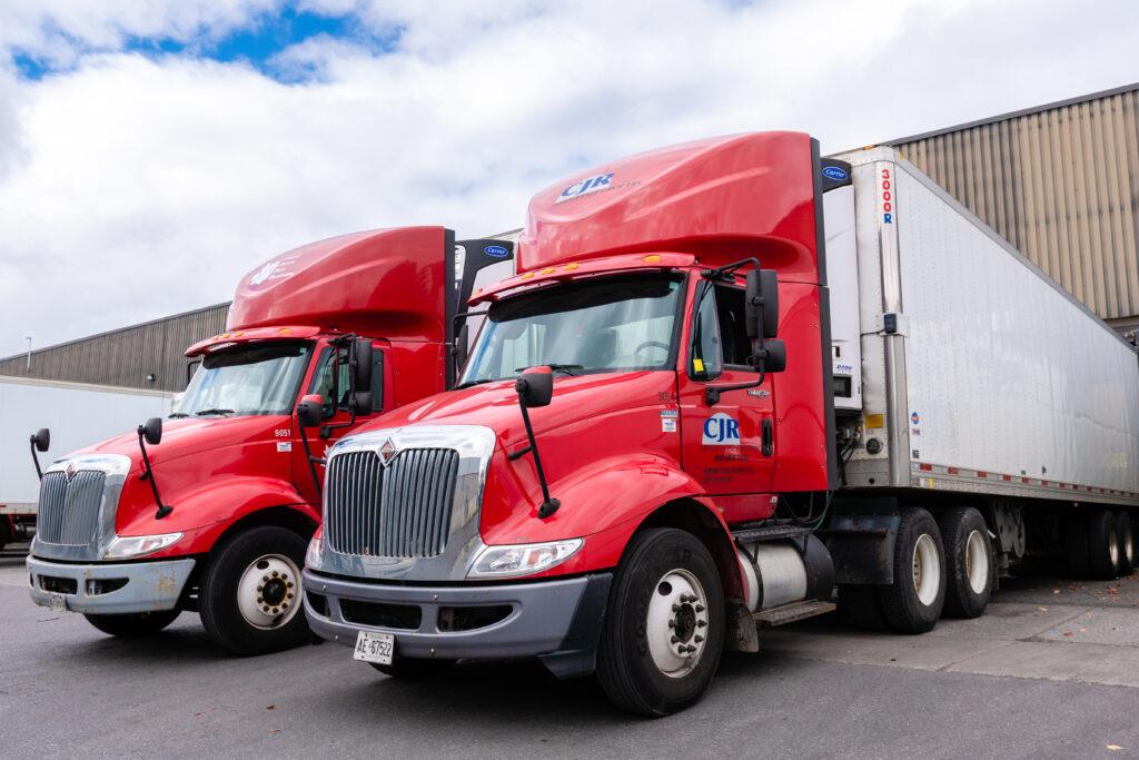 CJR trucks outside of warehouse