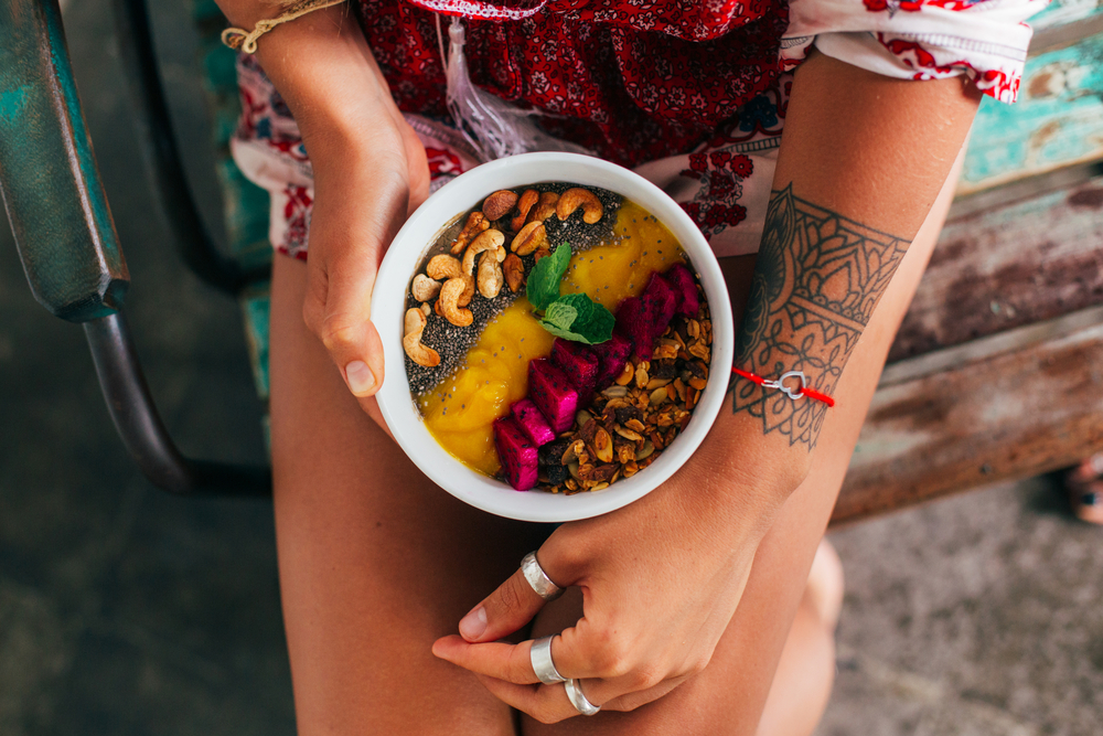 woman holding healthy nutritious food